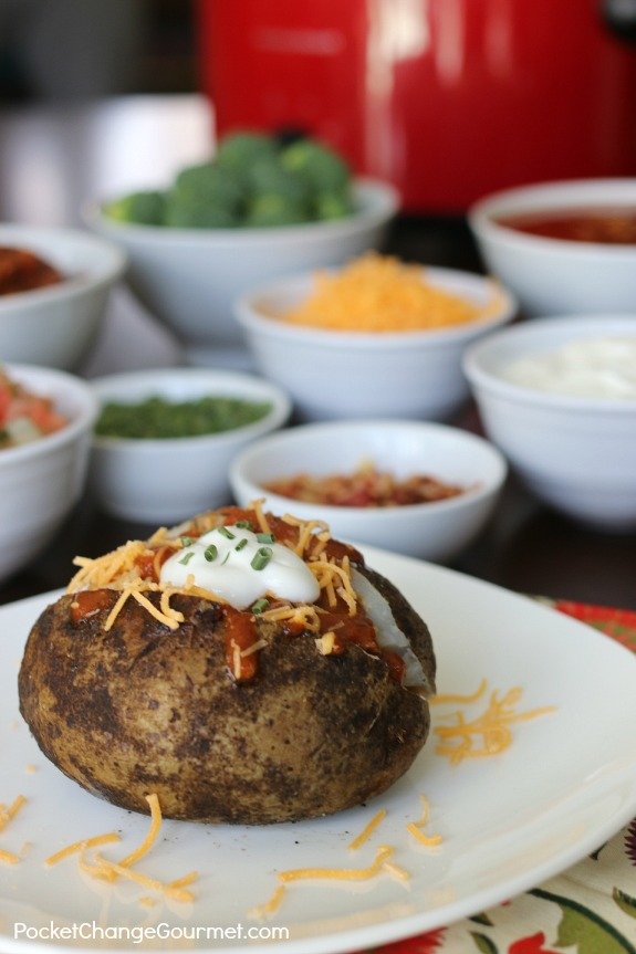 Slow Cooker Baked Potatoes - a simple and easy side dish, or add your favorite toppings and serve a Baked Potato Bar! Pin to your Recipe Board!