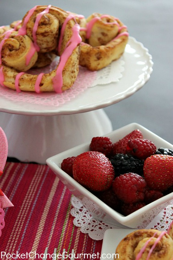 Valentine's Day Breakfast - complete with heart shaped pancakes, heart cinnamon rolls, heart potatoes, fruit and strawberry milk! Pin to your Recipe Board!