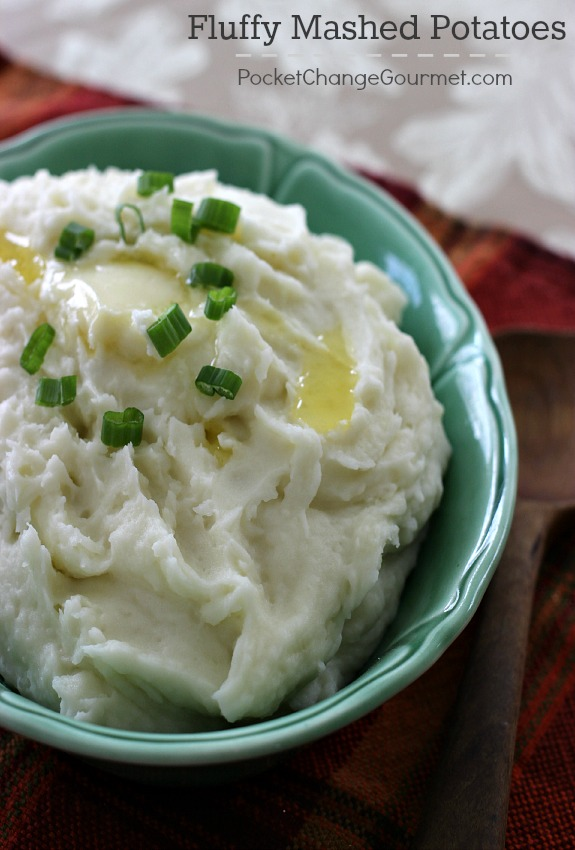 The ultimate comfort food - Fluffy Mashed Potatoes! Come on over and learn the secret ingredient to making the best Mashed Potatoes ever! Pin to your Recipe Board!