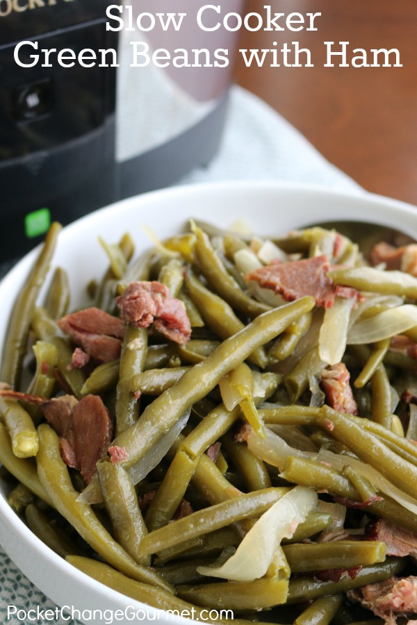 Enjoy these Slow Cooker Green Beans with Ham as a side dish or add some cornbread and make it a meal! Perfect recipe to use up leftover ham! Pin to your Recipe Board!