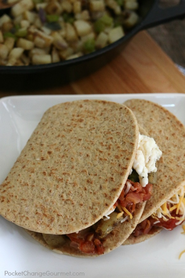 Breakfast on the go just got better! These Healthy Southwest Breakfast Wraps are super easy and delicious! Packed with flavor and filled with potatoes, bacon, onions, eggs, and salsa! Click on the photo to grab the recipe!