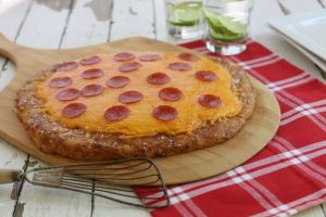 A new kind of after school snack! Delight your kids with this pretzel crust pizza!