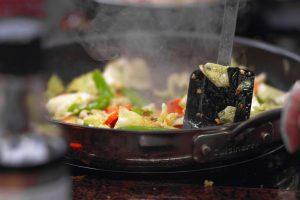 cooking chicken chop suey on wok