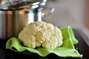 cauliflower on green textile