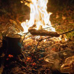 steak over a campfire