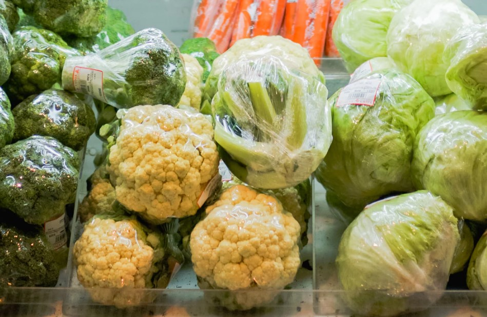 cauliflower, broccoli, and cabbage in the supermarket.