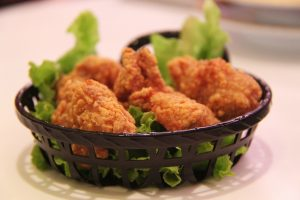 A basket of chicken that was cooked in a Kalorik air fryer